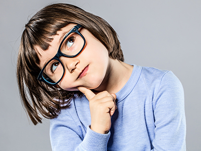 Girl with glasses thinking